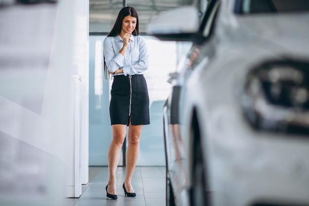 Young woman buying a car