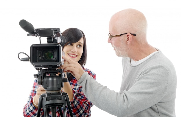 Young woman cameraman, and the mature man