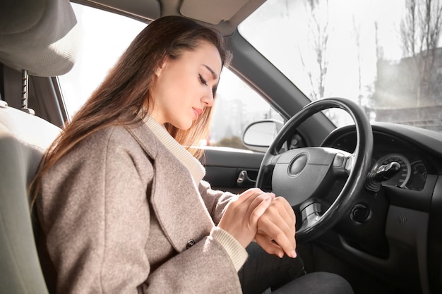 Young woman in car during traffic jam
