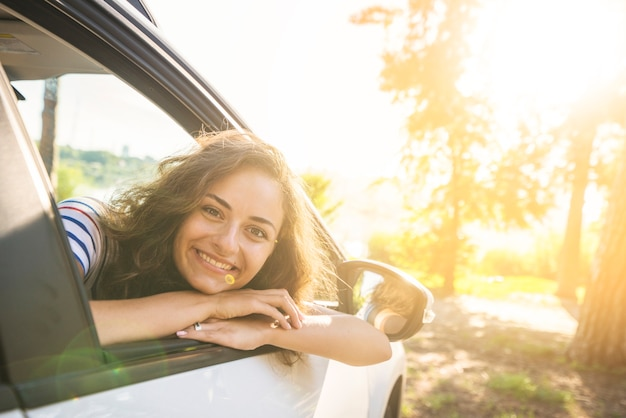 Young woman on a car trip