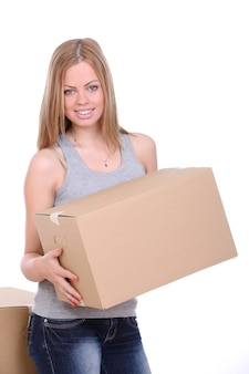 Young woman carrying cardboard box