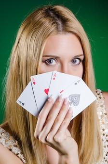 Young woman in casino gambling concept