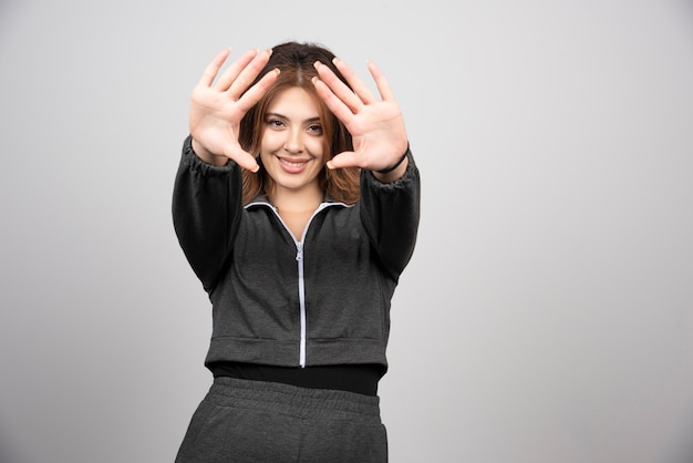 Young woman in casual clothes showing her hands .