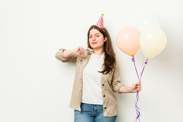 Young  woman celebrating a birthday feels proud and self confident