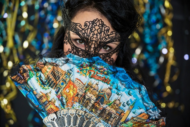 Young woman celebrating venetian carnival