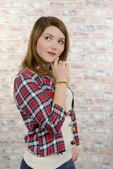 Young woman in a checkered shirt
