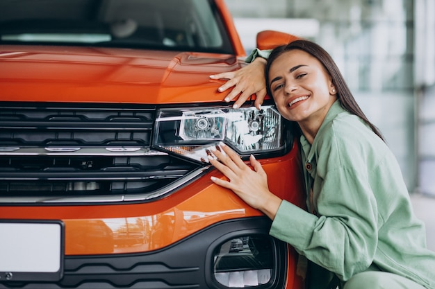 Young woman choosing a car for herself