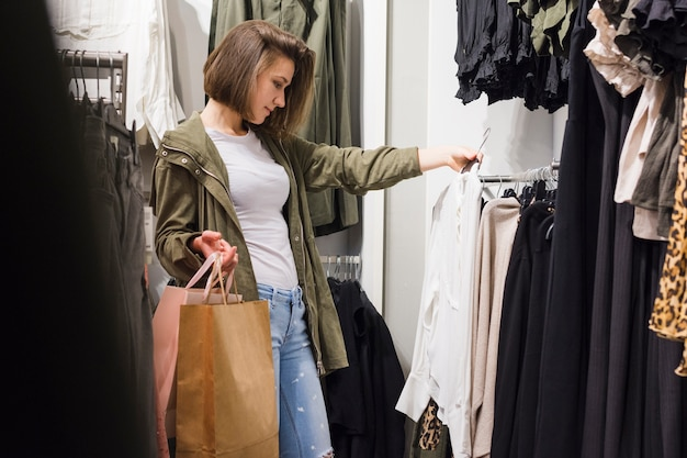 Young woman choosing different outfits