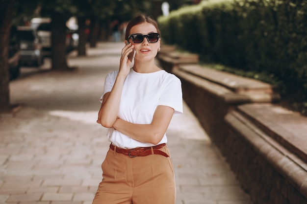 Young woman in city center talking on phone