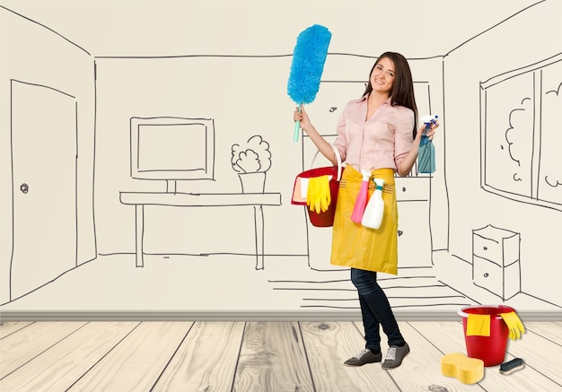Young woman cleaner with equipment on background