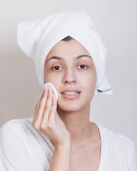 Young woman cleaning face process