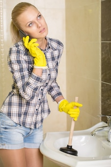 Young woman cleans the sink with air valves.