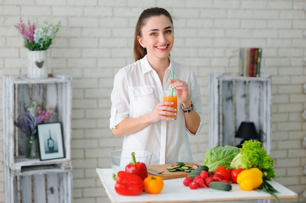 Young woman cooking healthy vegetable salad