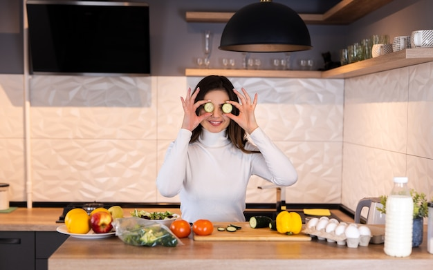 Young woman cooking in the kitchen. having fun. healthy food. dieting concept. healthy lifestyle. cooking at home. prepare food.