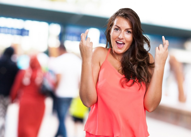 Young woman crossing fingers