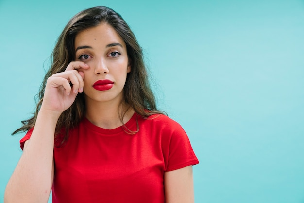 Young woman crying and posing