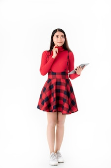 Young woman in cute red dress with tablet.