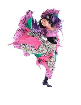 ジプシーの衣装を着た若い女性ダンサー。