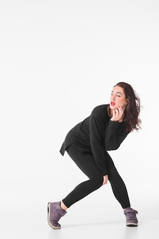 Young woman dancing hip hop over white background