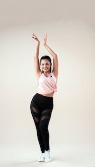 Young woman dancing with sportive clothes