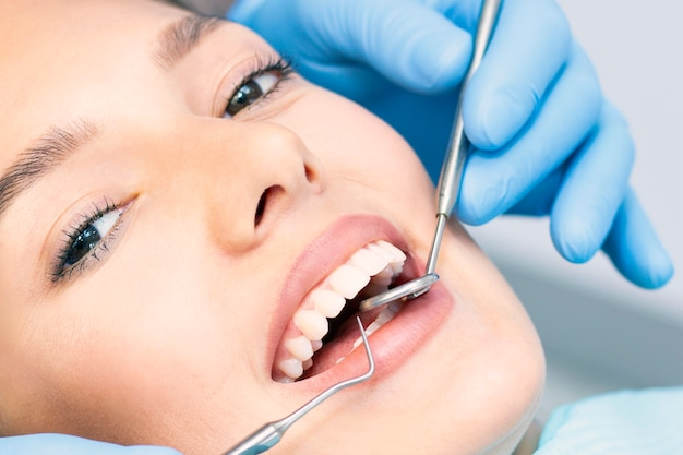 Young woman in a dental clinic with a male dentist