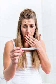 Young woman in desperation about the result of her pregnancy tes