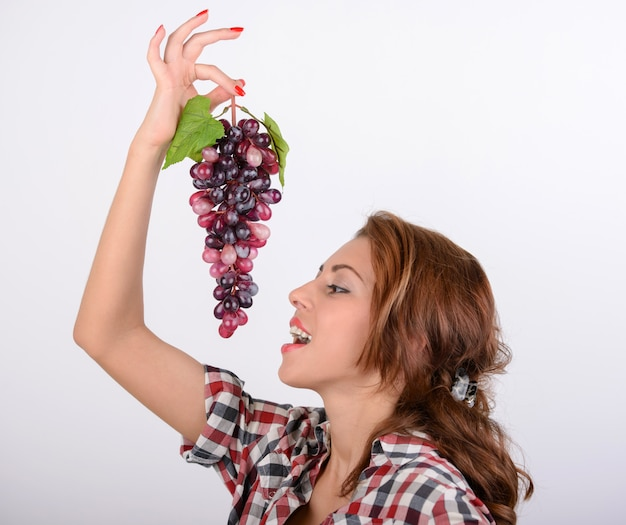 Young woman diet concept portrait with red grape