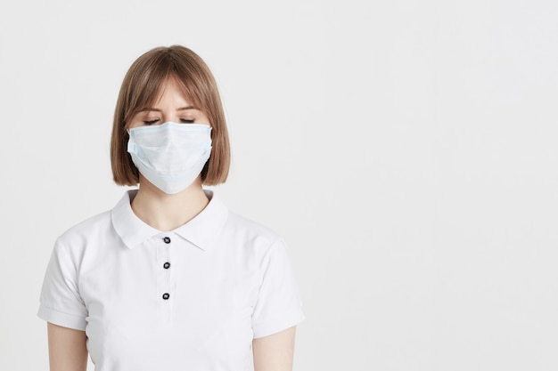 A young woman doctor in a surgical mask