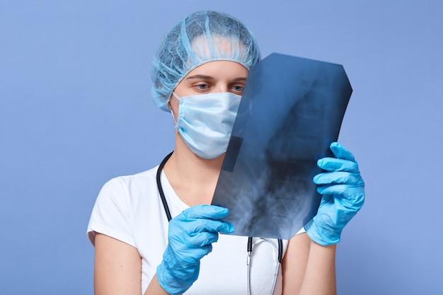 Young woman doctor who analysis x ray orthopantomogram
