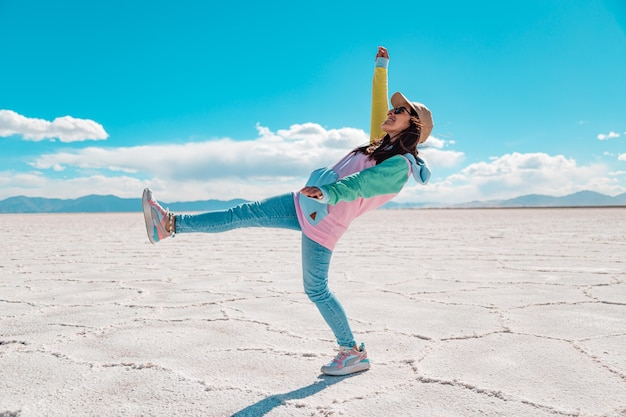 Young woman doing acrobats at salt lake