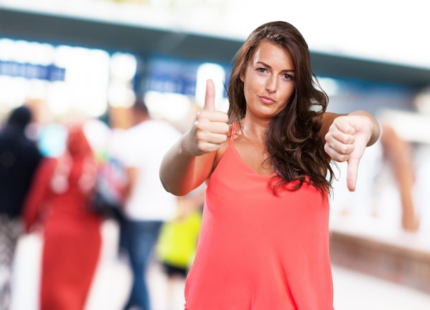 Young woman doing a contradictory gesture