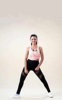 Young woman doing exercise with sport clothes