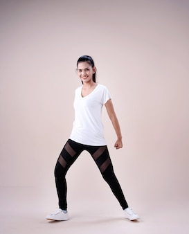 Young woman doing exercise with sportive clothes