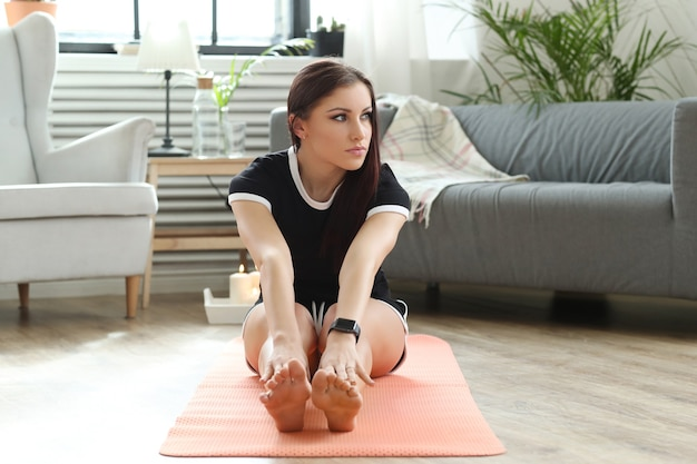 Young woman doing exercises at home