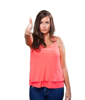 Young woman doing a gun gesture