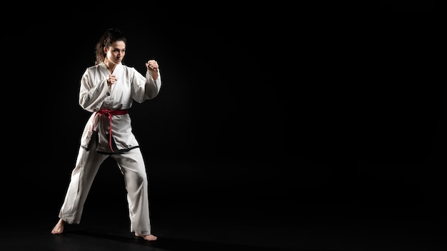 Young woman doing karate