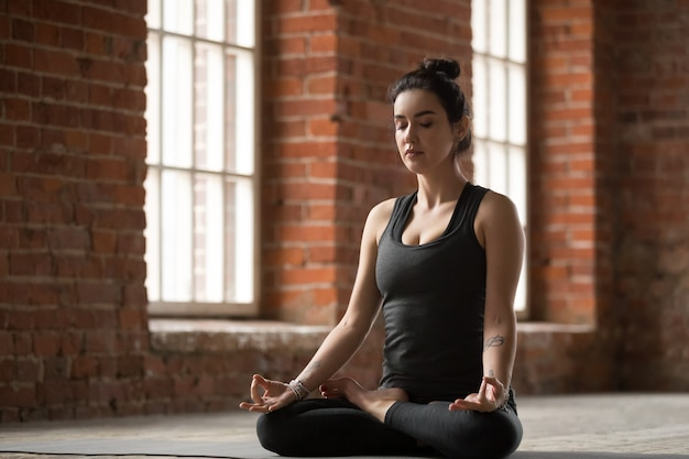 Young woman doing lotus exercise