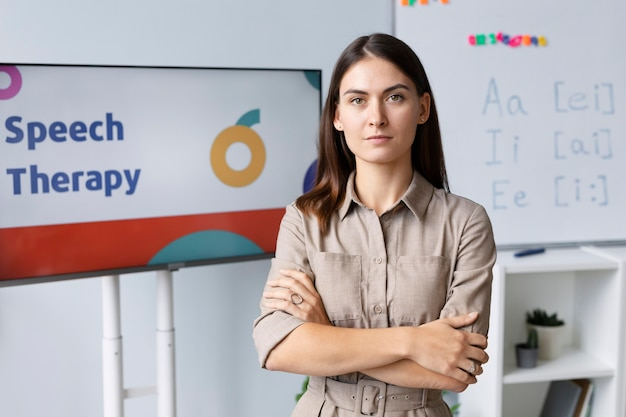 Young woman doing speech therapy for kids