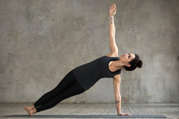 Young woman doing vasisthasana exercise