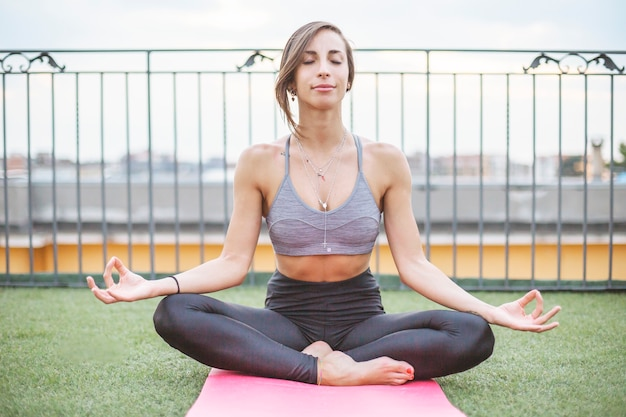 Young woman doing yoga outdoors