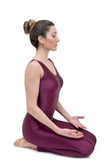 Young woman doing yoga in vajrasana pose
