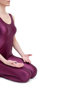 Young woman doing yoga in vajrasana pose