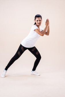 The young woman doing zumba dance workout, by clapping hand and point toe down, fbasic pattern for exercise,