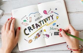 若い女性のノートブックで創造性を描く