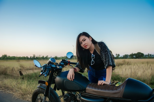 Young woman drive with motorbike on street, enjoying freedom and active lifestyle.