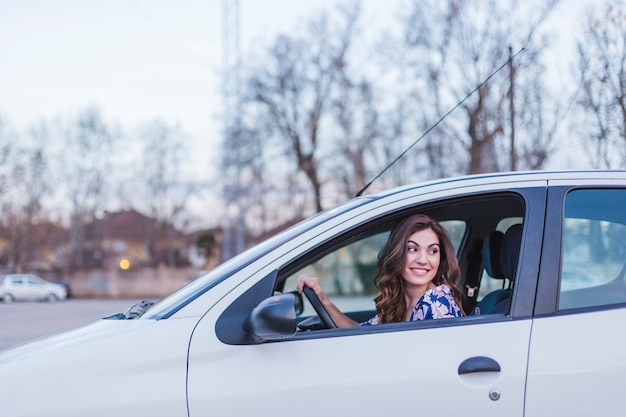Young woman driving a car in the city.