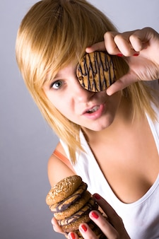 Young woman eating chocolate chip cookies