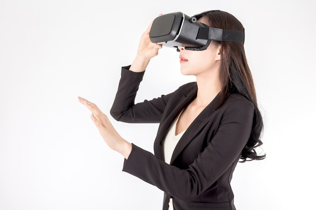 Young woman enjoy with virtual reality glasses on white background
