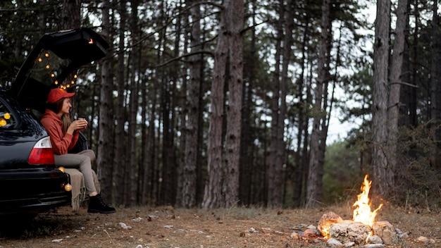 Young woman enjoying bonfire