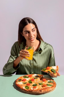 Young woman enjoying a delicious pizza